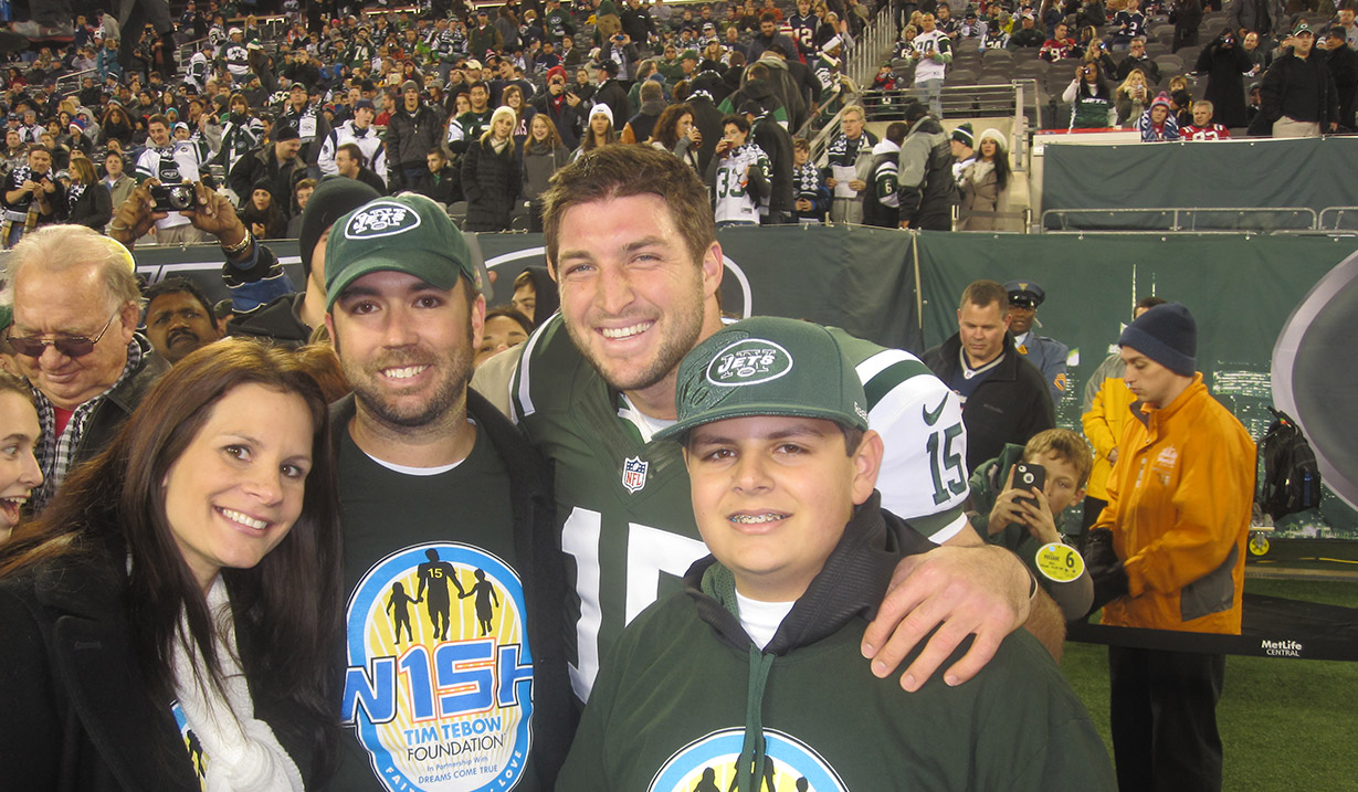 PJ_Harris_W15H_with_Tim_Tebow_-_2012.JPG