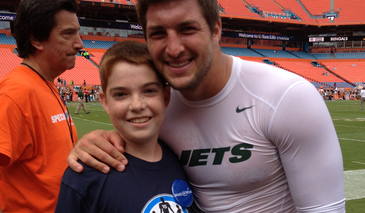 Thomas_Raleigh_W15H_with_Tim_Tebow_-_2012.jpg