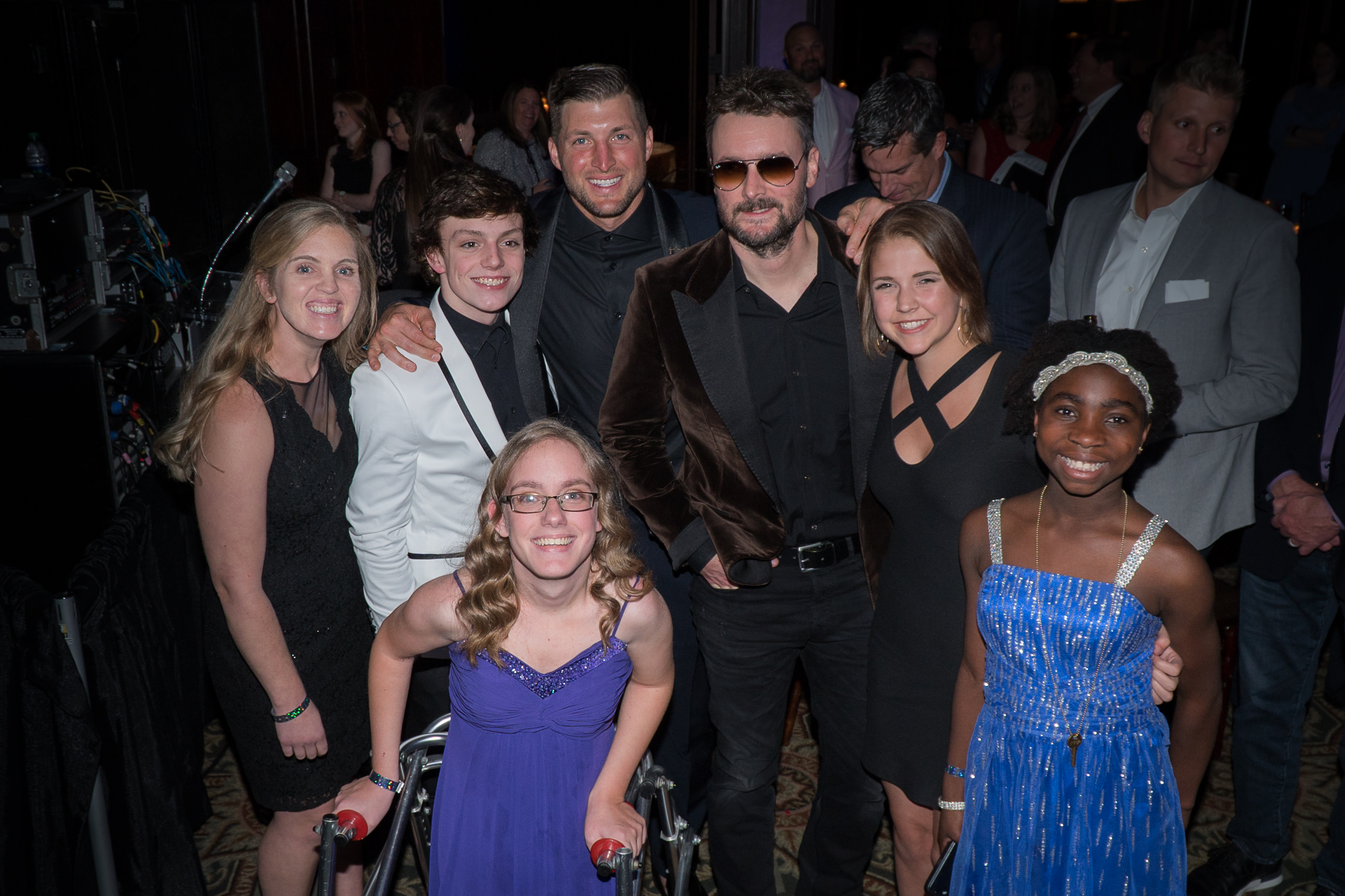 Erich_Church__Tim_Tebow_pose_with_TTF_ Managedry_guests.jpg