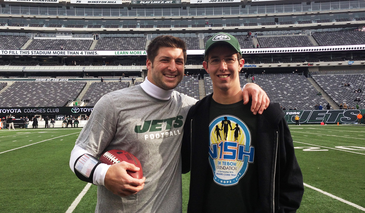 Adam_Smith_W15H_with_Tim_Tebow_-_2012.JPG