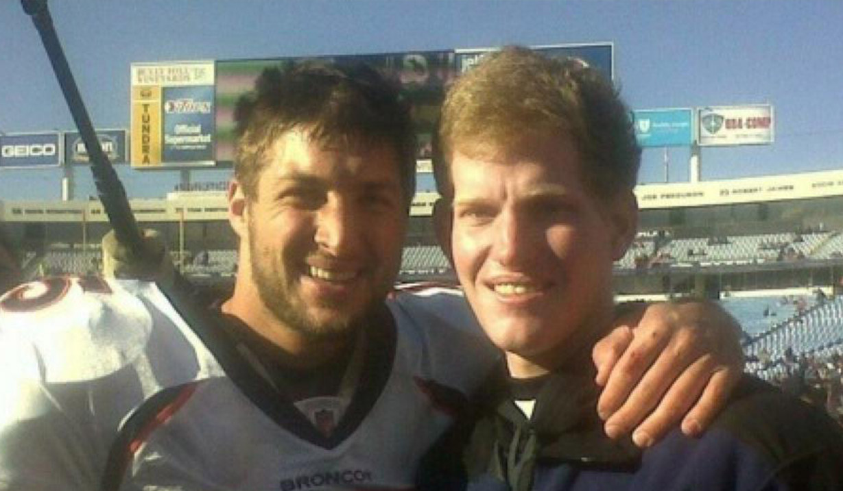 Jacob_Rainey_W15H_with_Tim_Tebow_-_2011.jpg