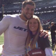 Kelly Collins W15H with Tim Tebow - 2012.JPG