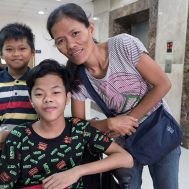 Clarence and his family are welcomed into the Tebow CURE Hospital.jpg