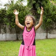 Jocy 6 months after surgery to repair her badly burned arms.jpg