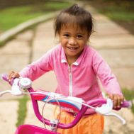 Jocy rides a bike for the first time in her life thanks to her successful surgical procedure.jpg